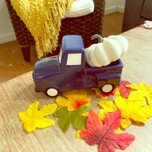 Little mini navy blue truck and white pumpkin
